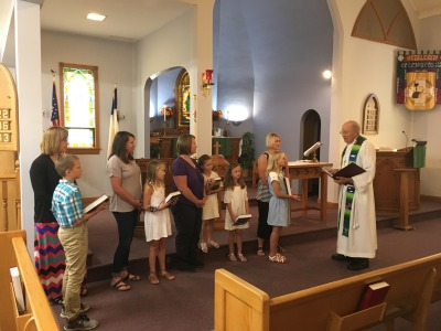Sunday School kids getting their Bibles